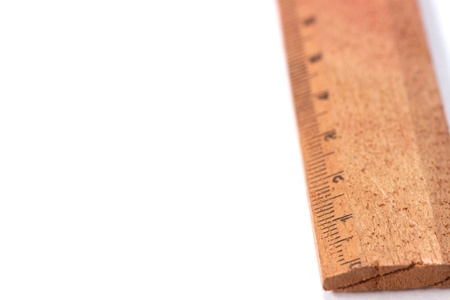 An old wooden ruler on the right side
