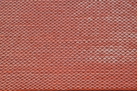 Thai temple red roof with overlap tiles photo