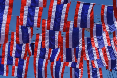 Thai flags hanging in the sky photo