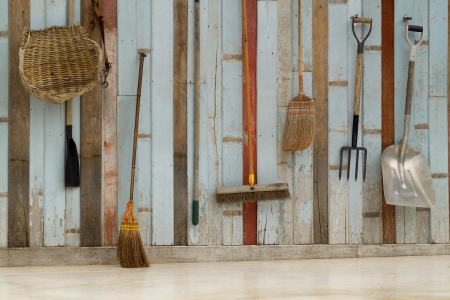 Gardening tools hanging on the wooden wall