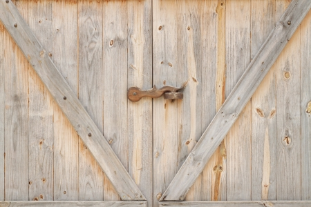 Old style wooden door with lock photo