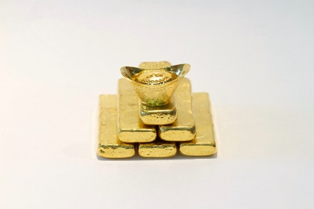 Gold bar on the white background photo