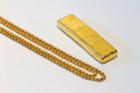Gold bar and gold necklace photo