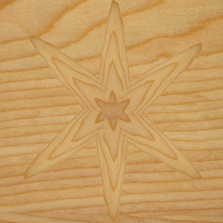 Flower shape texture on light brown wood Stock Photo