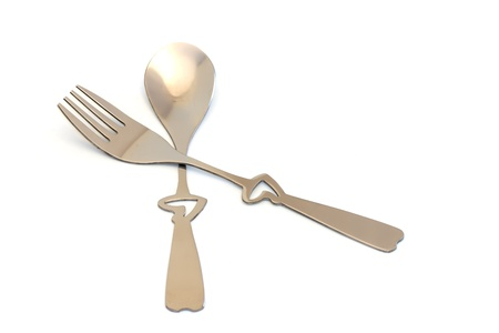 Spoon and fork with heart shape handle photo