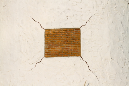 White cracked wall with brick texture photo