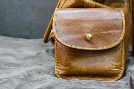 Side of brown leather bag Stock Photo