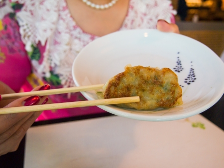 gyoza: Woman is going to eat gyoza