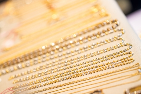 Gold necklaces shining in shop Stock Photo