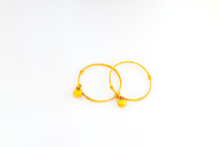 anklet: Gold anklet with little bell for baby Stock Photo