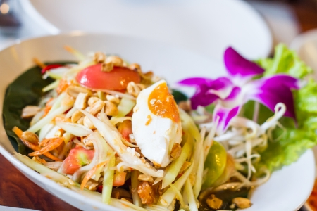thai style papaya salad with salty egg Stock Photo