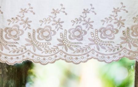 white handicraft with flower pattern curtain