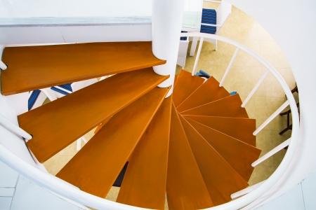 design of spiral wood stairs in coffee shop Standard-Bild