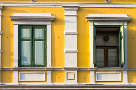 open and close window on yellow building