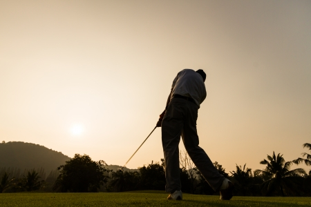 silhouette shot of golfer swing action