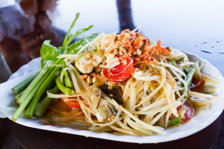 Thai style spicy papaya salad with fresh crab Stock Photo