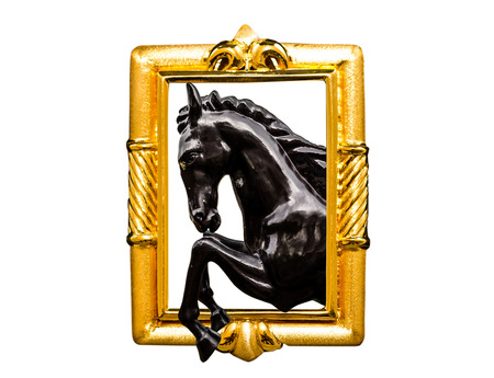 black horse sculpture in golden frame photo