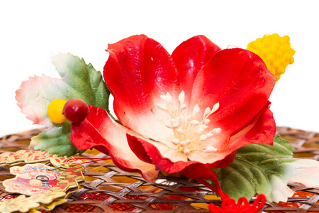 counterfeit: red counterfeit flower decorated on basket Stock Photo
