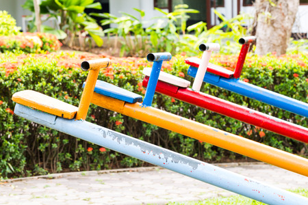 totter: side of colorful seesaw at playground Stock Photo