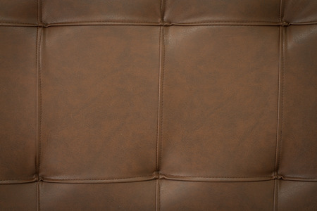 bedhead: dark brown leather of bedhead Stock Photo