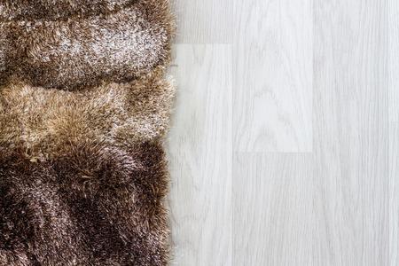 fur carpet and wooden floor Standard-Bild