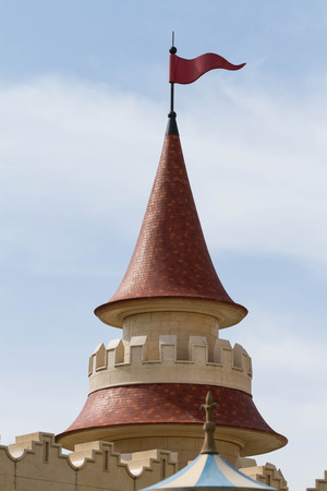 apical: top of castle roof with red flag