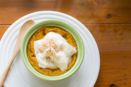 pumpkin pudding topped with whipped cream