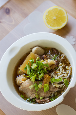 steamed pork noodle in white bowl photo