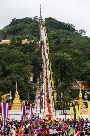 UTHAITHANI, THAILAND - OCTOBER 9 :Tak Bat Devo Festivals,The row of Buddhist monks walk down from hill to take food offering from people. October 9,2014 in Uthaithani, Thailand.