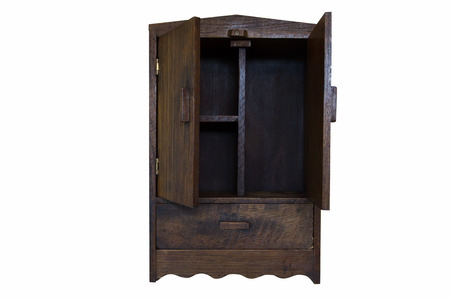 ancient design wood cupboard isolated on white background, open doors photo