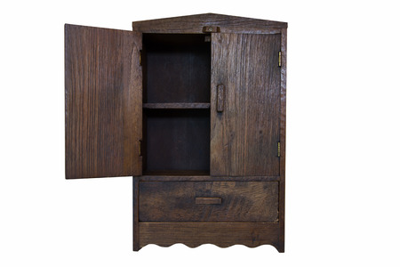 ancient design wood cupboard isolated on white background, left door opened photo