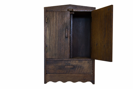 ancient design wood cupboard isolated on white background, right door opened photo