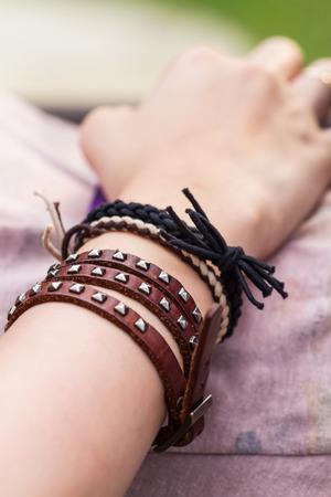 closeup ladys arm with leather bracelet Stock Photo