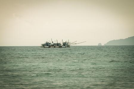 green tone: green tone fishing ships in the sea