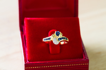 red box: sapphire and diamond gold ring in red box