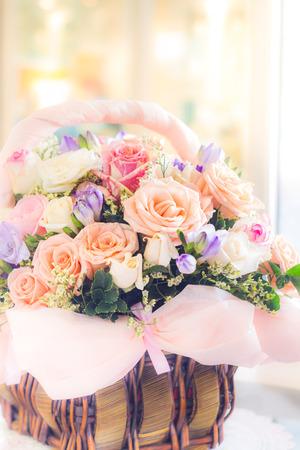 pastel color roses in basket