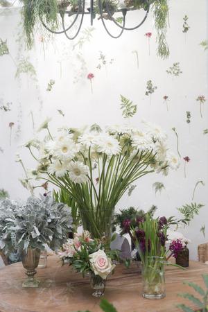 aster flowers: aster flowers vase in garden room Stock Photo