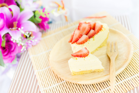 piece of strawberry tart on wood dish photo