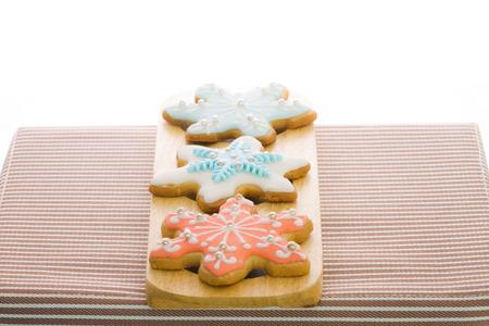 sugar cookies: snowflake sugar cookies on wood dish