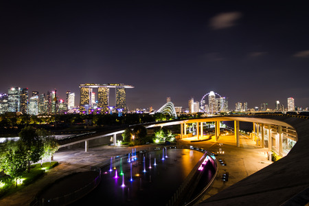 billion: SINGAPORE - April 16, 2015: Marina Bay Sands in the evening. It is the worlds most expensive building with cost of US$ 4.7 billion and landmark of Singapore. Editorial