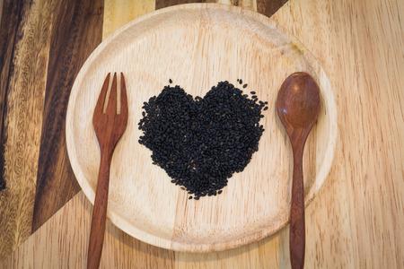 heart shape black sesame on wooden plate