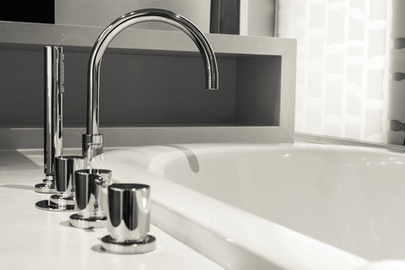 closeup faucet and bathtub in bathroom