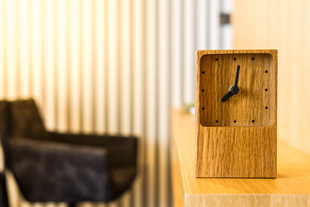 wooden clock: wooden clock decorated on worktable