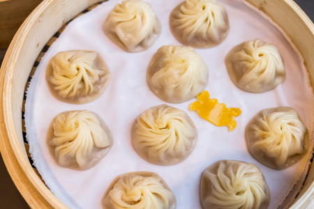 bao: chinese style food called xiao long bao, minced pork and crab dumpling with soup inside