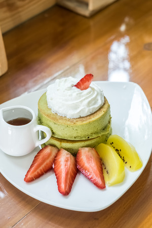 special green tea pancake with fresh strawberry and golden kiwi
