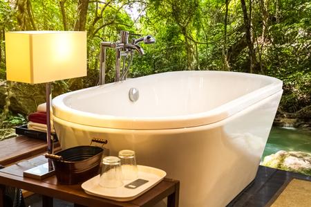 hotel bathroom: bathtub in bathroom with natural view Stock Photo