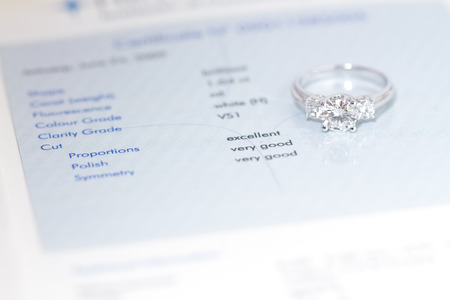 woman diamond ring on certificate background 写真素材