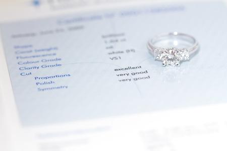 woman diamond ring on certificate background Standard-Bild