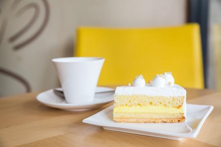 serve: piece of lemon cake serve with cup of tea Stock Photo