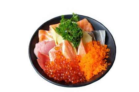 mixed sashimi on rice in black bowl on white background, donburi, japanese food 写真素材